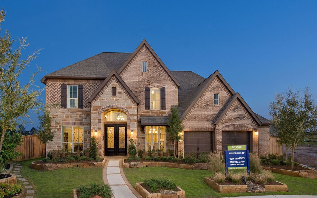 Model home at dusk in Elyson community